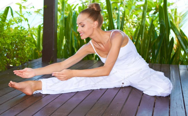 Graceful woman stretching doing yoga
